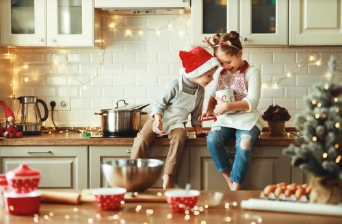 happy children baking for holidays during christmas