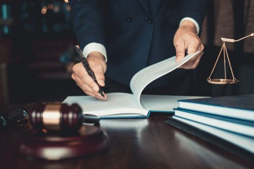 attorney writing notes on paper