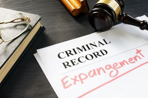 Expungement written on a criminal record.