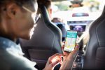 Woman Using a Car Sharing App